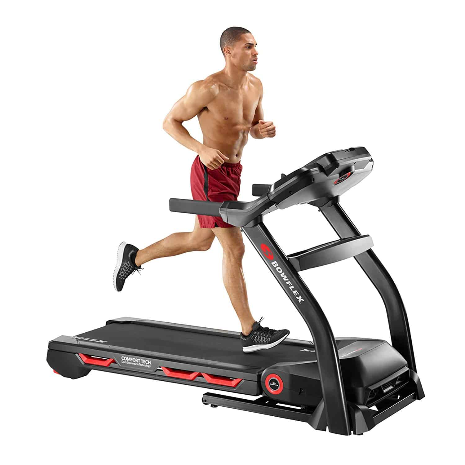 Shirtless man in red shorts running in a Bowflex treadmill