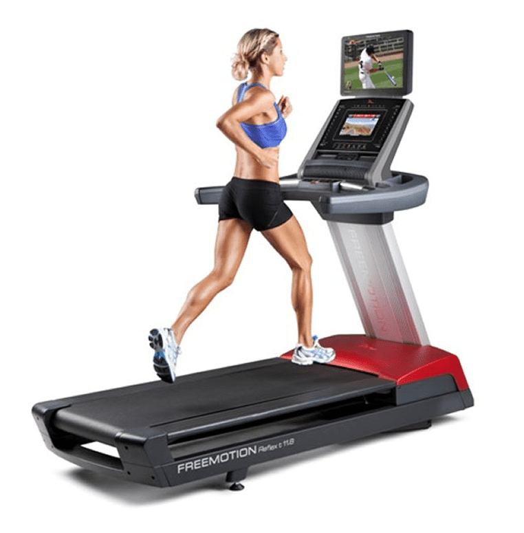 Woman wearing a blue sports bra and black shorts while running in a FreeMotion Reflex t11.8 Treadmill