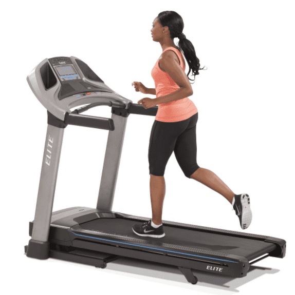Woman doing some exercise with the horizon treadmill