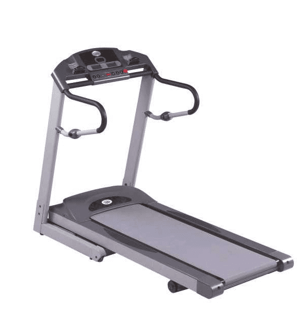 Woman in red top and black short running in a Weslo cadence r 5.2 treadmill