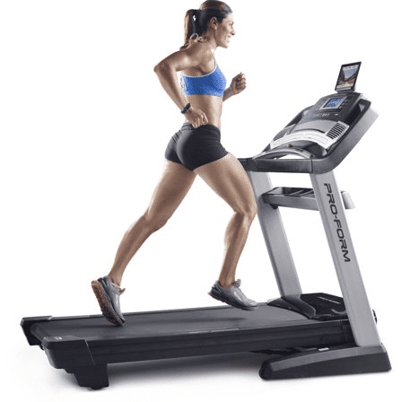 Woman in blue sports bra and black shorts running in a ProForm Pro 2000 Folding Treadmill