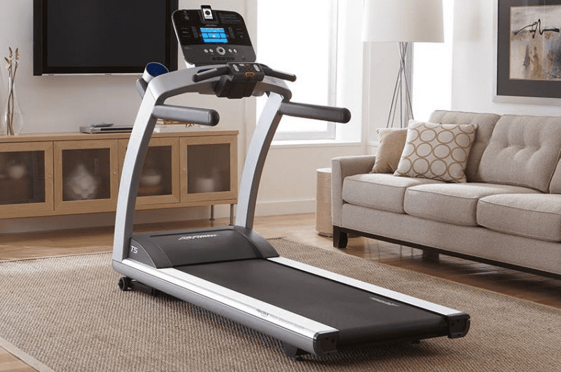 Black with silver lining treadmill placed inside a house