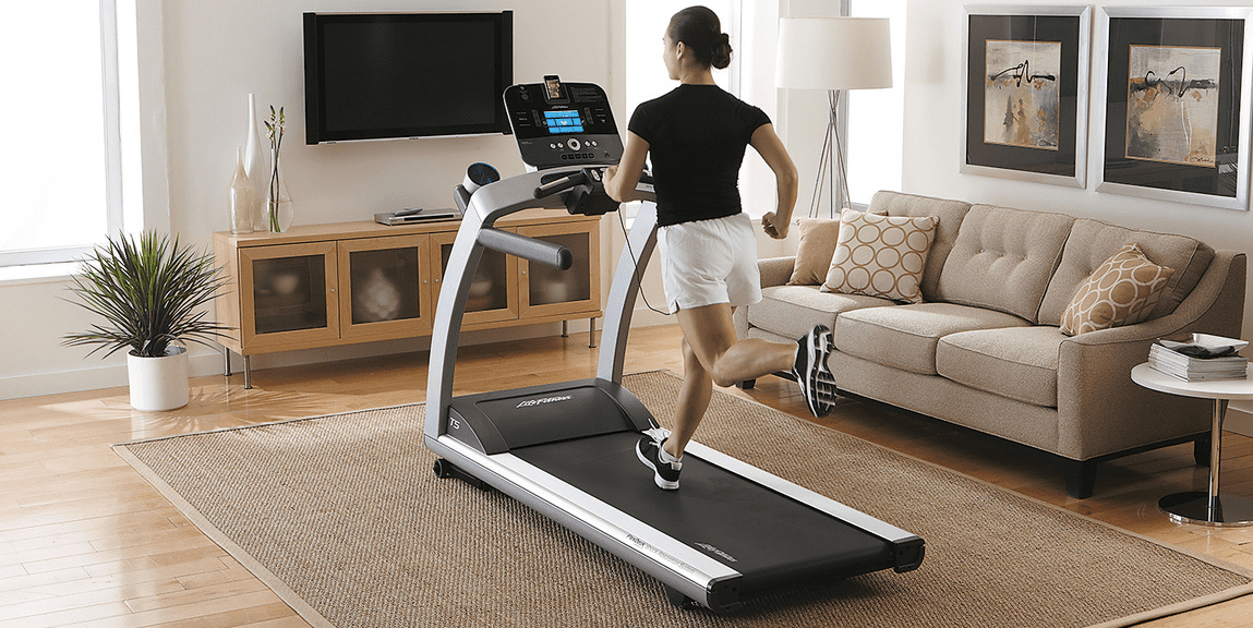 Woman in black shirts and white shorts running in a treadmill inside his house