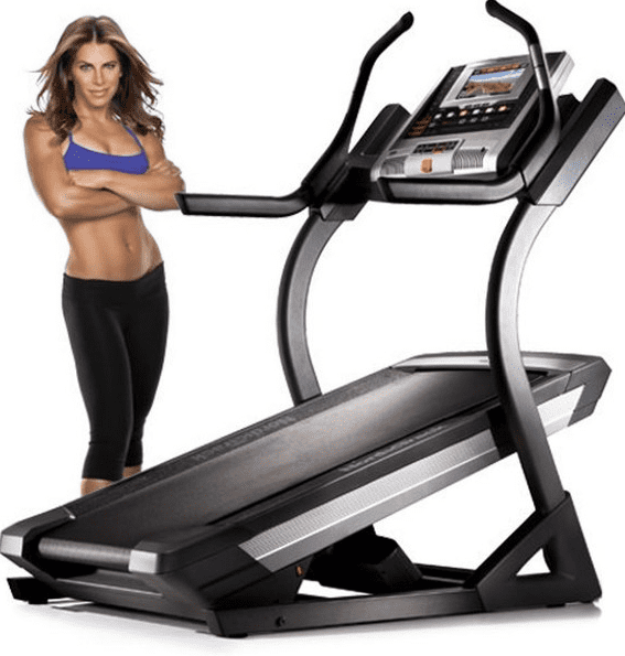 Woman in sports bra modelling beside a treadmill