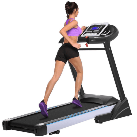 Girl wearing a pink top and running in a treadmill