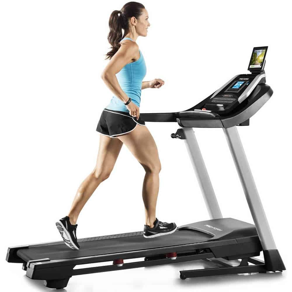 woman using the Proform 505 CST Treadmill